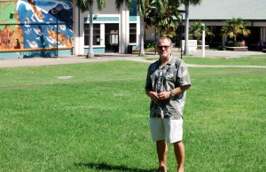 """Tim Botkin stands on the proposed site of the first """"Sustainability Lens"""" project, which would feature landscaping, shading and composting."""