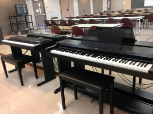 Laulima Room 105 provides both pianos and space for students.