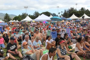 Most people were not fazed by an entrance fee and the turn out for the event had record numbers. People watching live music.