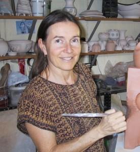 Jennifer Owen works on a ceramic sculpture.