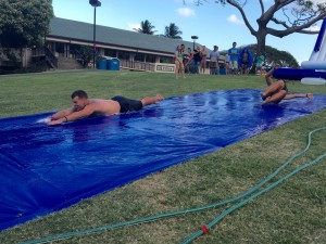 Pierre Parranto and SAC president Bryan Pluta take the first run down the Great Lawn slip and slide.