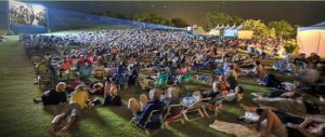 Attendees get comfy on the grass under the stars for the Celestial Cinema Credit: Maui Family Magazine