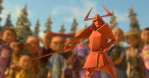 A origami samurai springs magically to life in front of an audience.