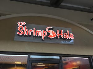 The inviting logo at the entrance of Da Shrimp Hale.