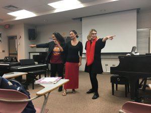 "Students Zoe, Wailana and Kahea of the group ""Kaleo O Kalani"" performing their group piece."