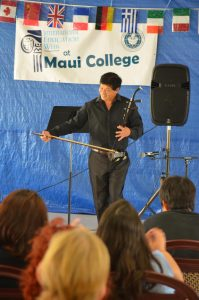 Man plays the Erhu at last year's International Day