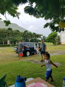 Hui Haumana club members participate in a car wash to gather food for students on campus.