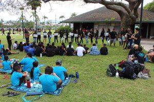 Students play music together at Makahiki