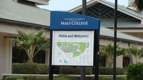 Building of UHMC with a sign displaying a map of the campus.