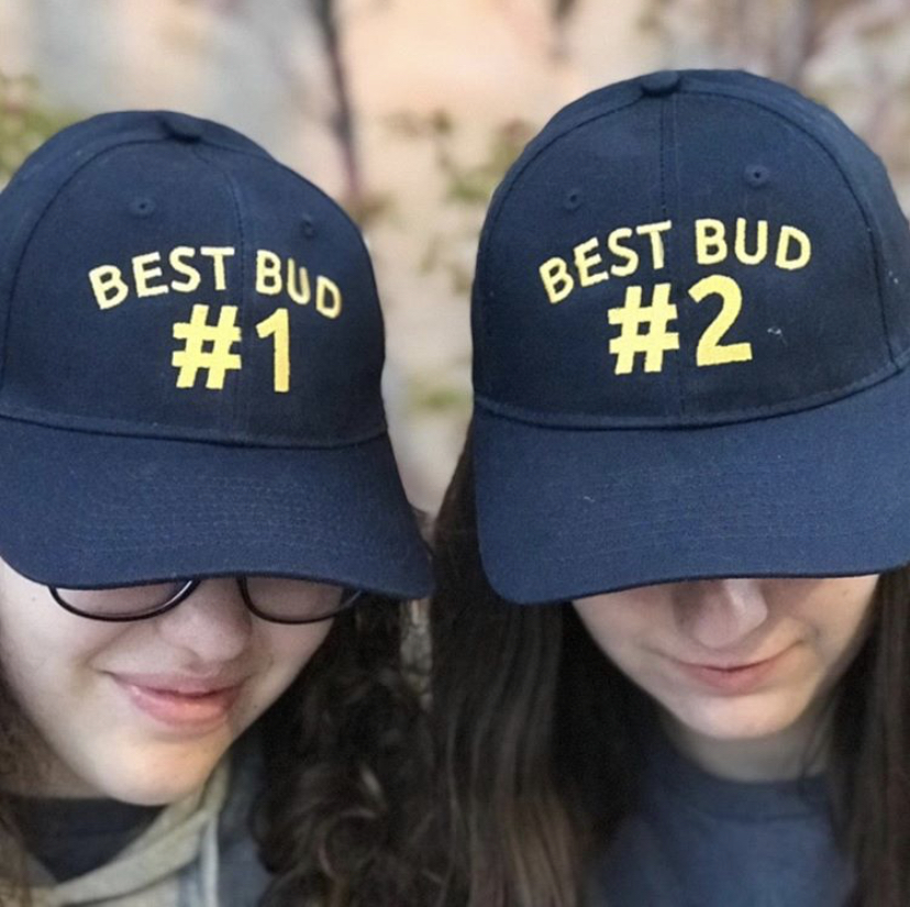 """Kat n Nat wearing matching hats which say """"Best Bud 1 and Best Bud 2"""""""