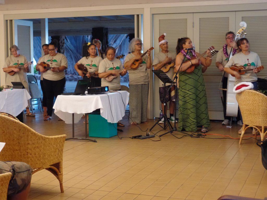 Students play Hawaiian music at the Christmas gathering.